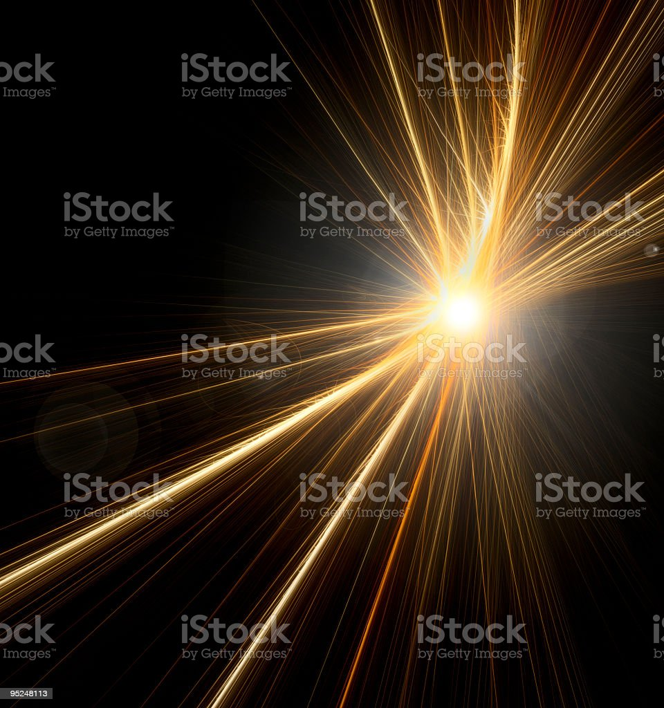 Starburst from a lens flare on black background  royalty-free stock photo