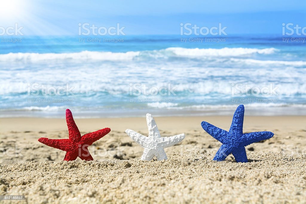 Starfish on beach during July fourth stock photo