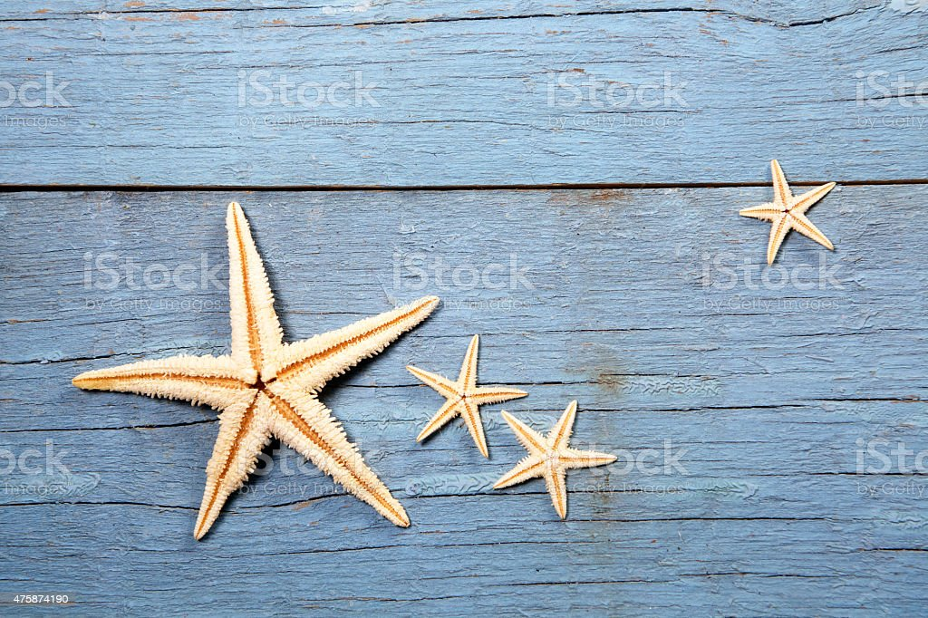 starfish on wooden background stock photo