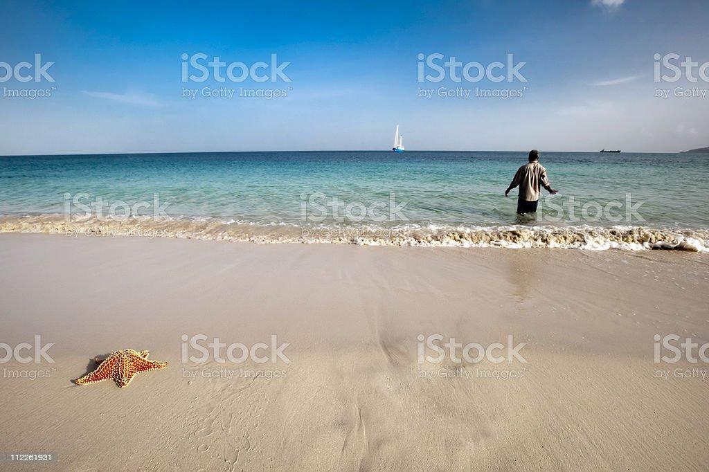 starfish, sail boat and man stock photo