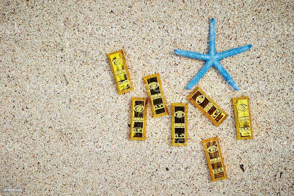 Starfish with gold bars stock photo