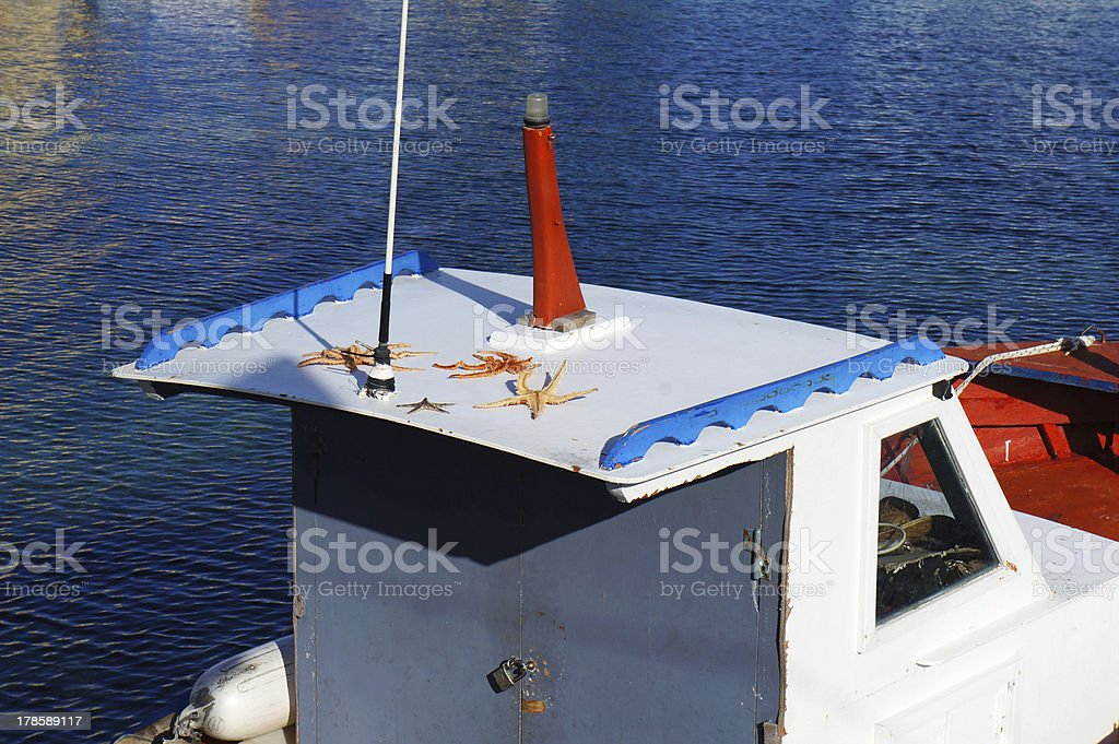 Starfishes on a white boat royalty-free stock photo