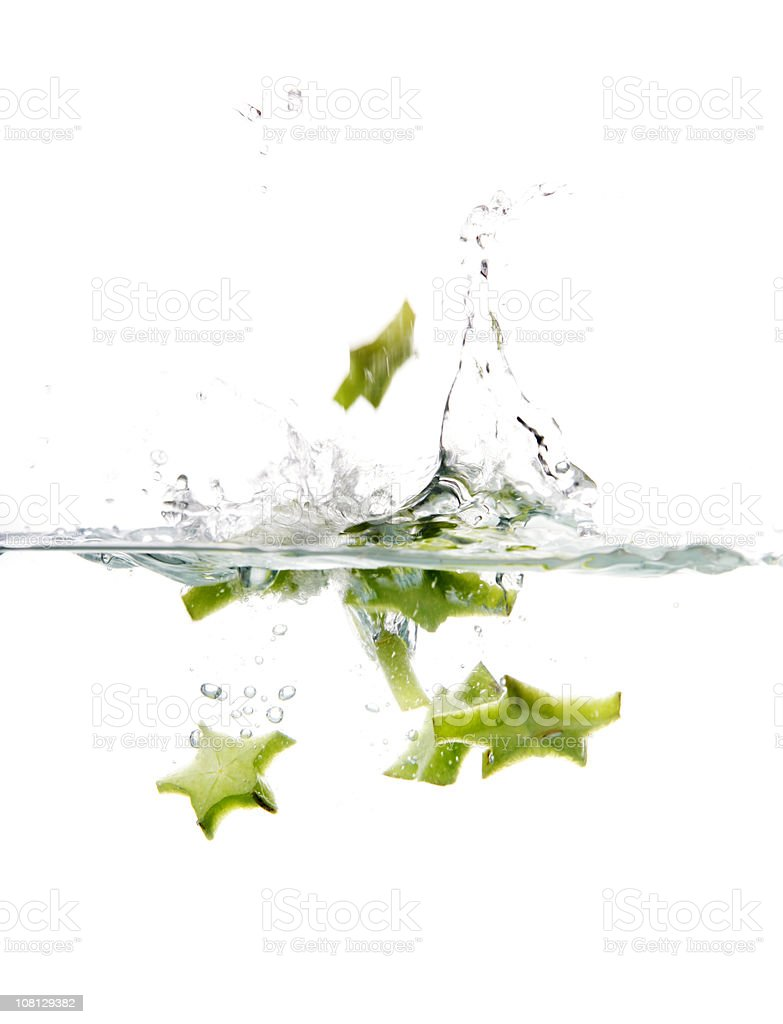 Starfruit Splashing in Water stock photo