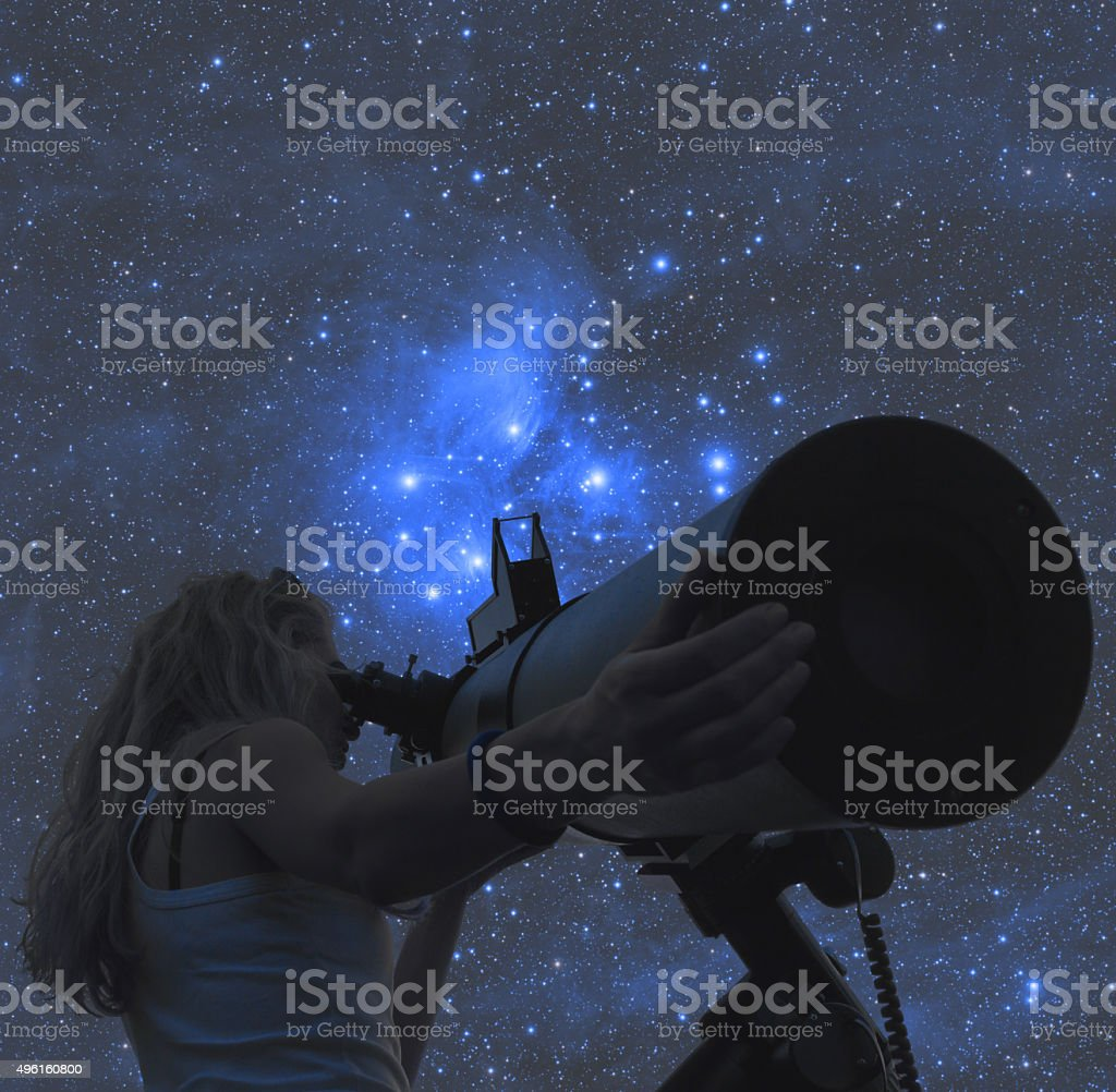 Stargazing through a telescope stock photo