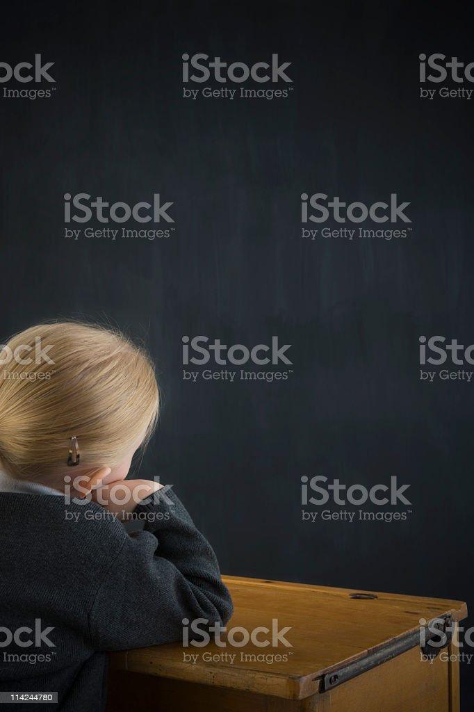 Staring at school blackboard royalty-free stock photo