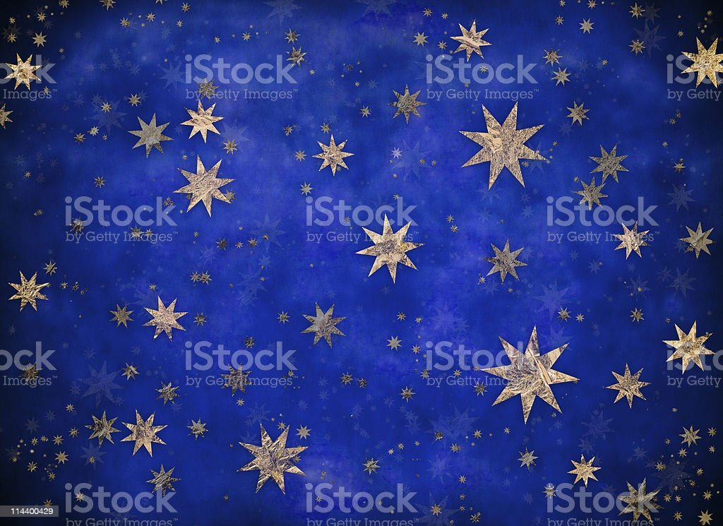 Starry Christmas background with gold foil stars stock photo