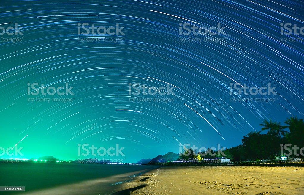 Starry night above beautiful tropical beach stock photo