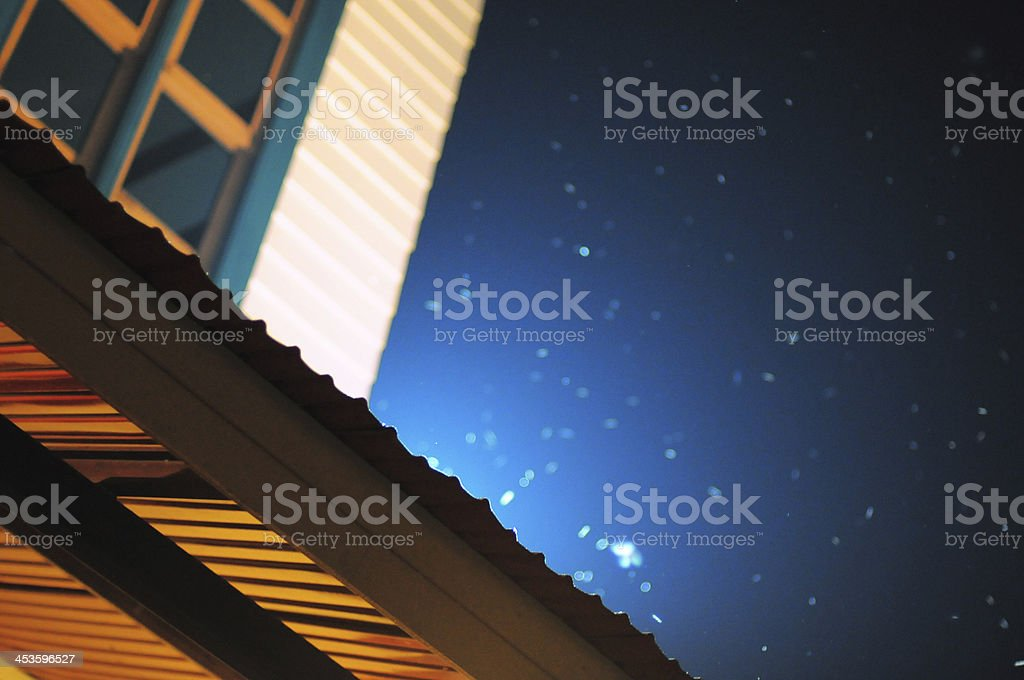 Starry night above roof royalty-free stock photo