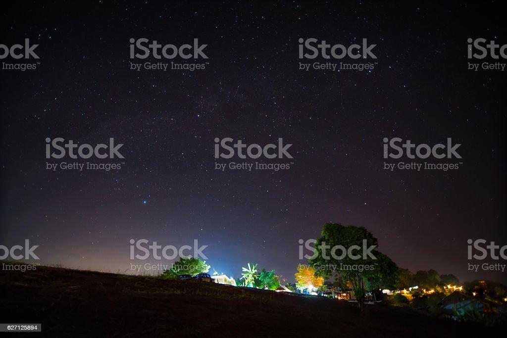 Starry night over tribe village on mountain. stock photo
