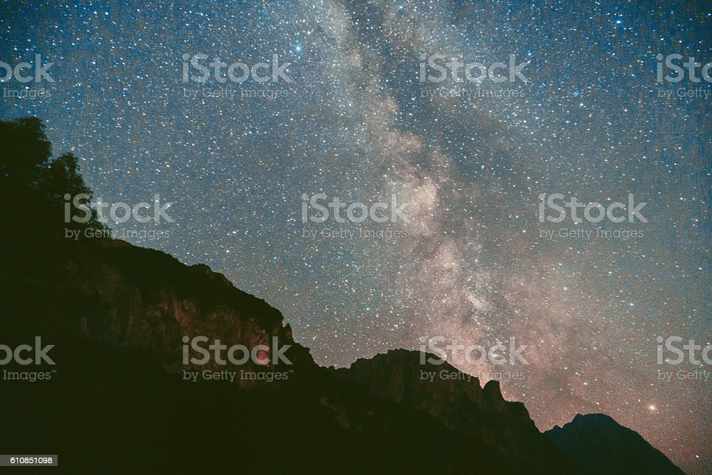 Starry sky above the mountains stock photo
