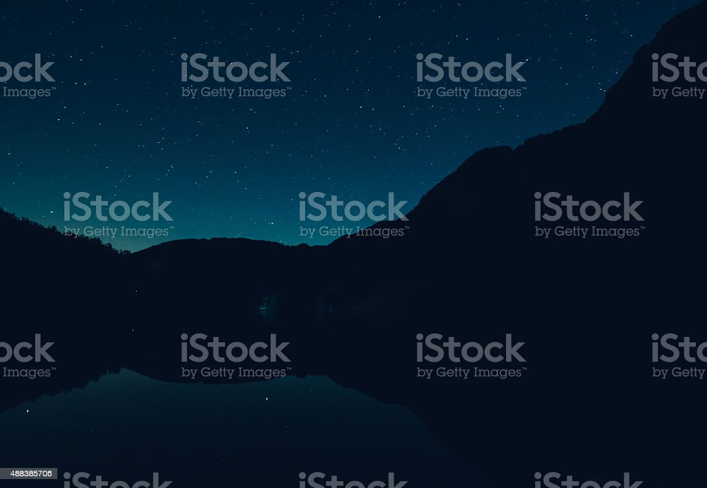 Starry Sky On A Mountain Lake stock photo