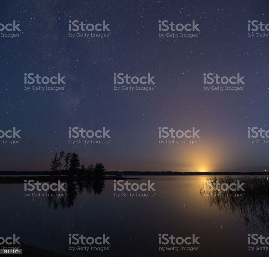 Starry Sky over a lake stock photo