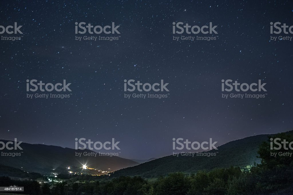 Starry sky over French village in mountains stock photo