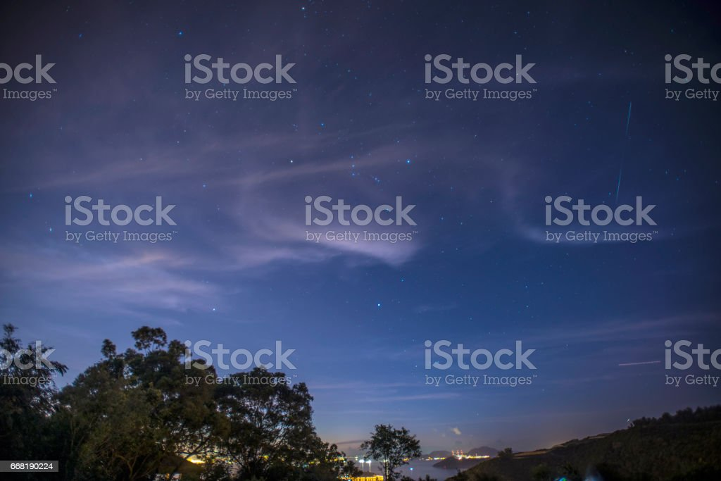 Starry sky over Lantau East, Hong Kong, at dawn stock photo