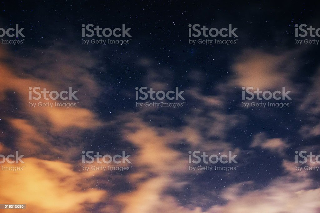 starry sky with clouds stock photo
