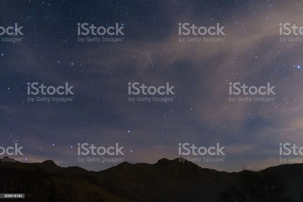 Starry sky with Ursa Major and Capella from the Alps stock photo
