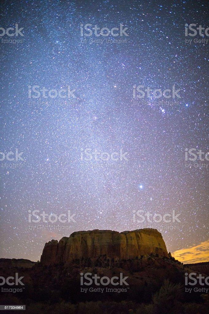 Stars and Milky Way above mesa stock photo
