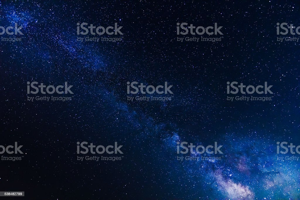 Stars and Milky Way Galaxy on clear dark night sky stock photo