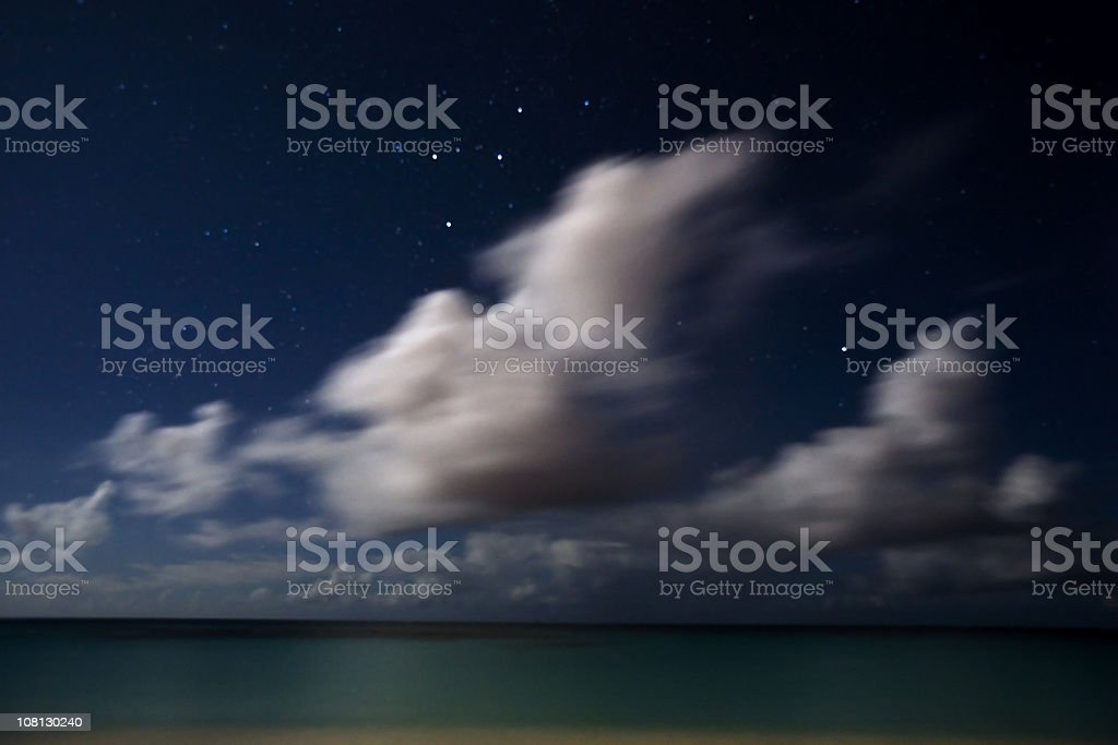 Stars and Moonlit Clouds stock photo