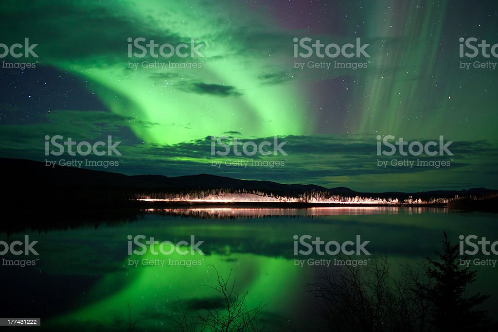 \'Night Sky Stars, clouds and Northern Lights over country road at...