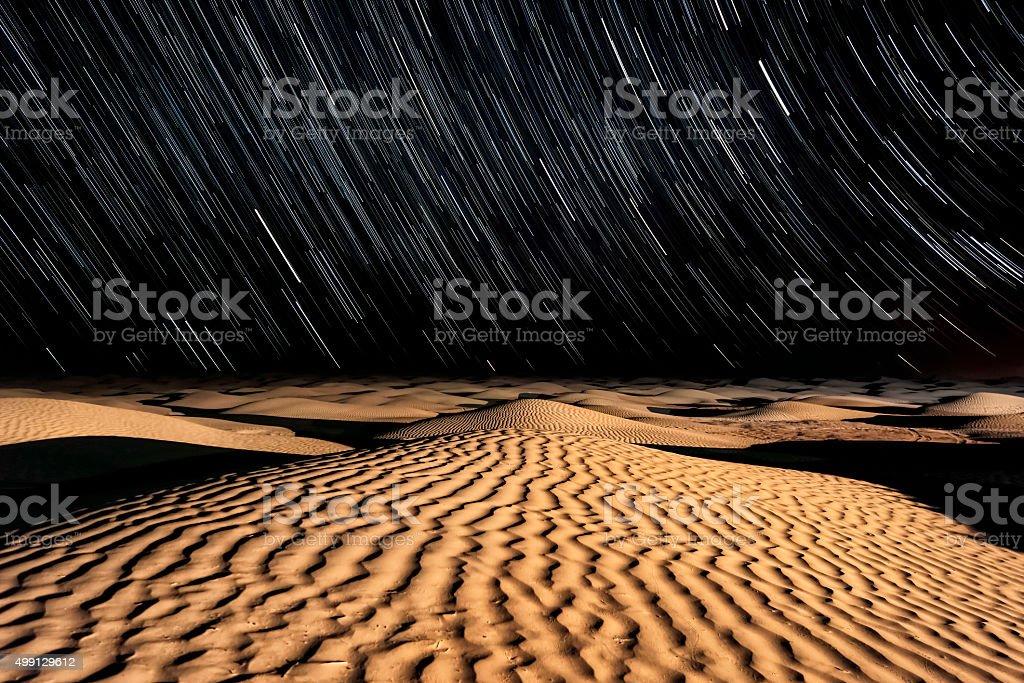 Stars and Sand - Night sky in the Sahara Desert stock photo