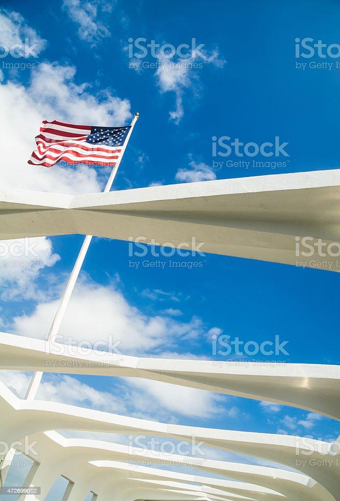 Stars and Stripes above the Arizona Memorial stock photo