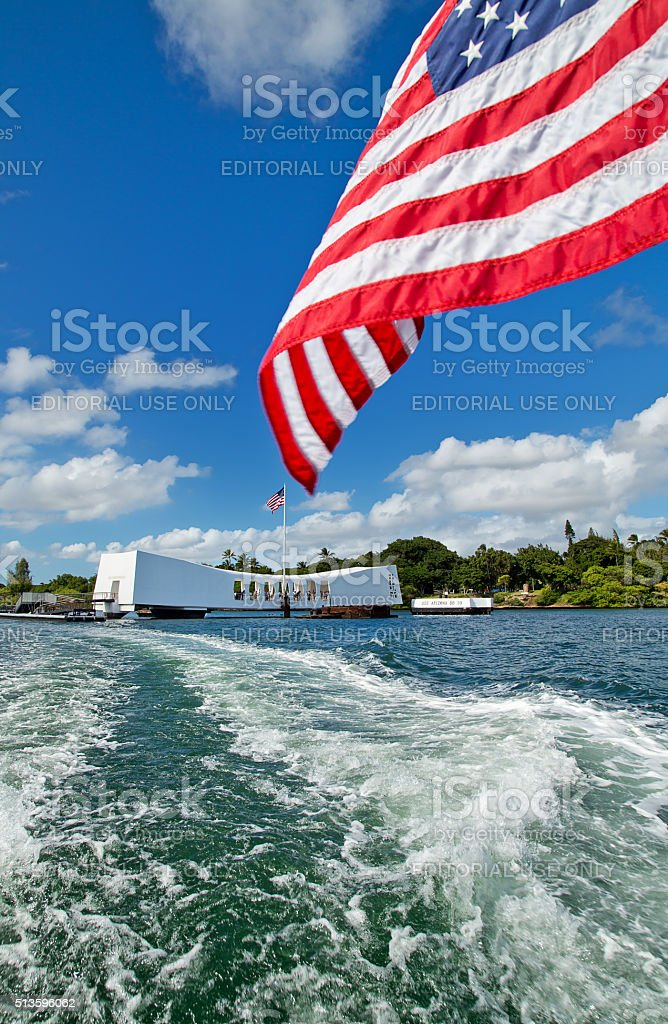 Stars and stripes flying at the USS Arizona memorial stock photo