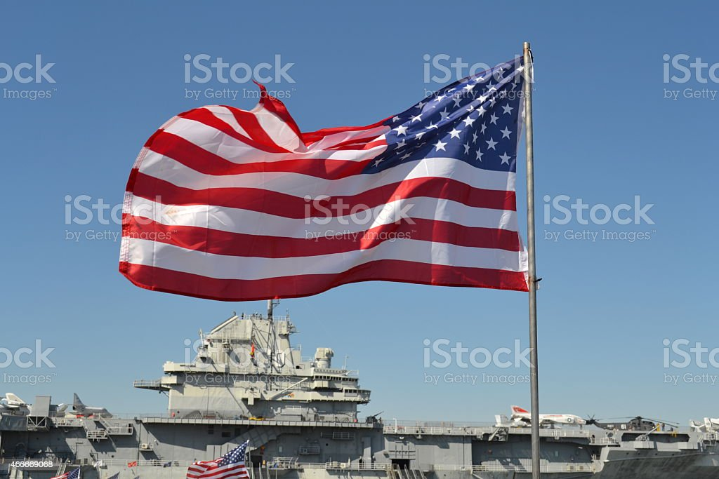 Stars and Stripes in front of USS Yorktown stock photo