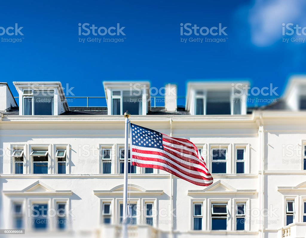 Stars and Stripes Infront of a White Building stock photo