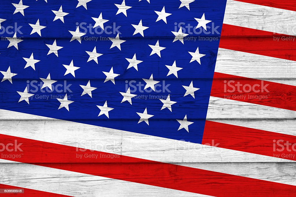 Stars and stripes on wood planks stock photo