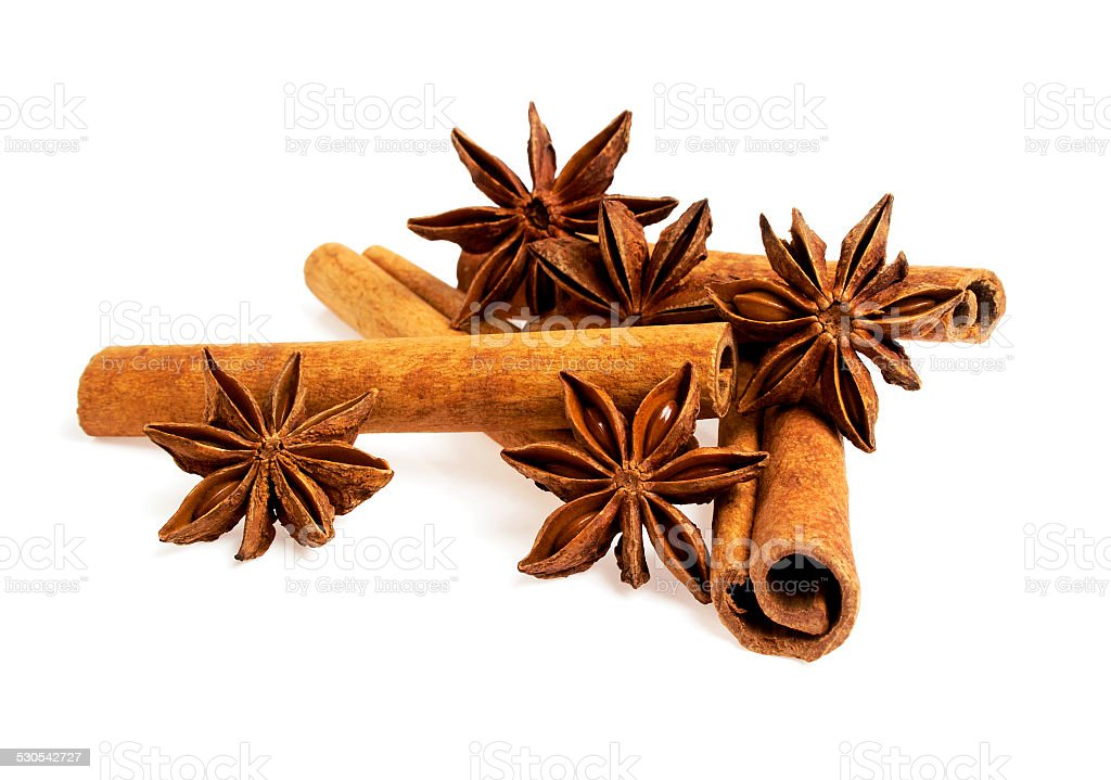 Stars anise and cinnamon isolated on a white background stock photo