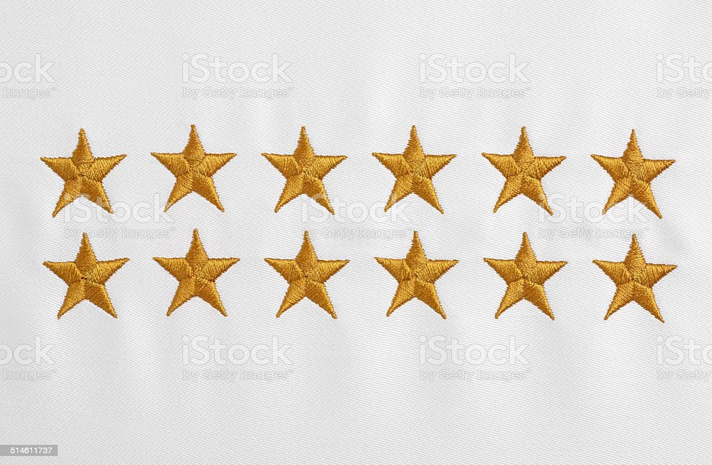 Stars embroidered on white cloth stock photo