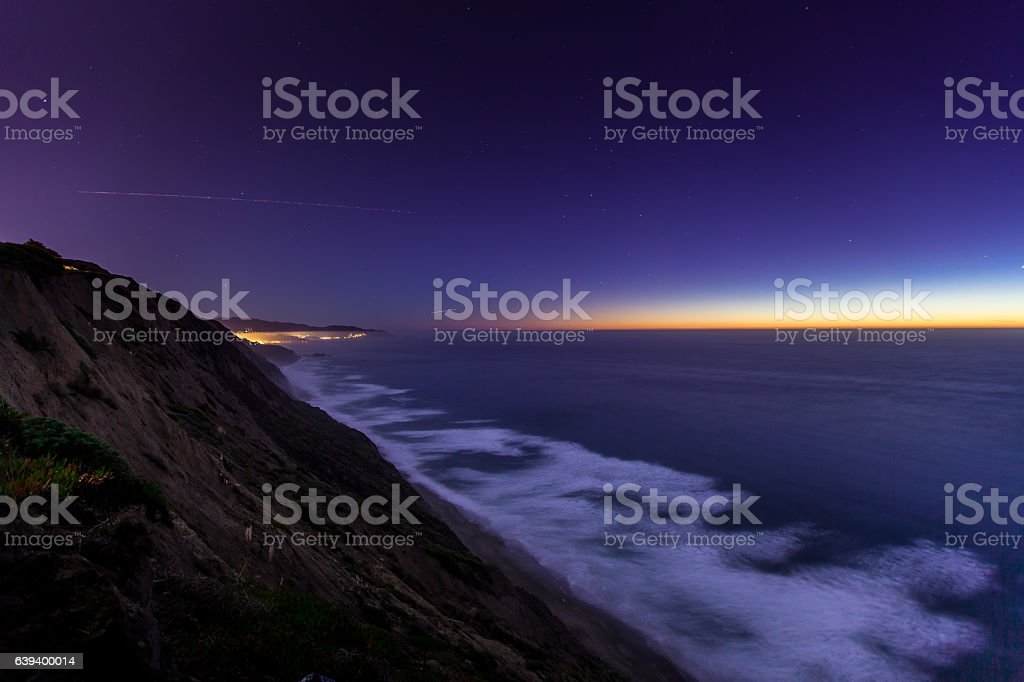 Stars Emerging Over the Pacific stock photo