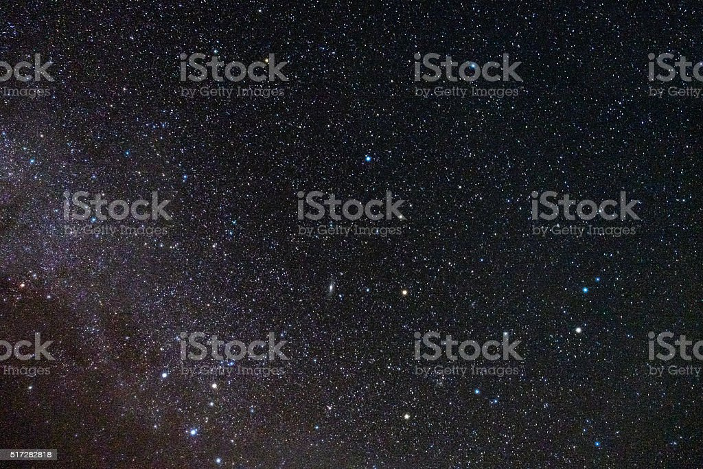 Stars fill the sky in the dark stock photo