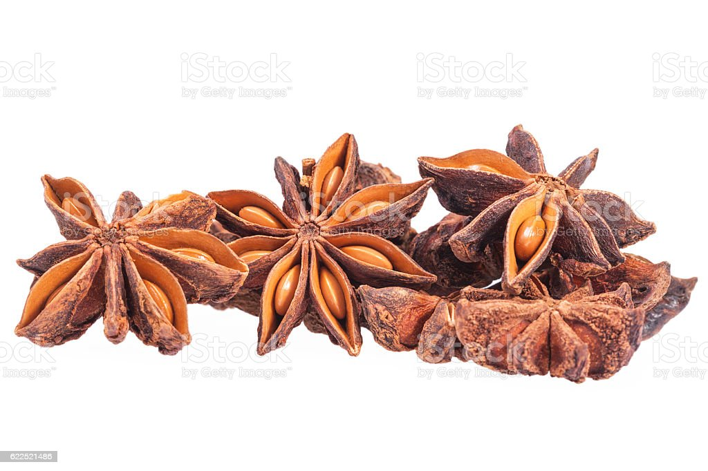 Stars of dried anise (Illicium verum) isolated on white background stock photo