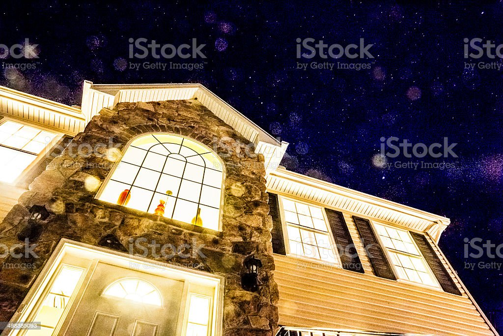 Stars on the sky above the living house stock photo