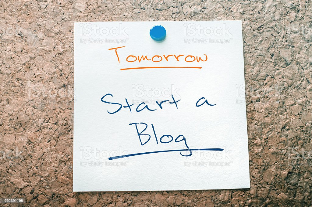 Start A Blog Reminder For Tomorrow Pinned On Cork Board stock photo