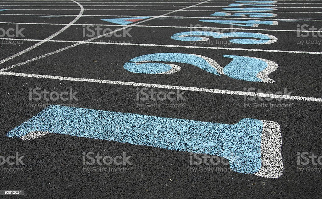 Start line in white and blue of a racing track royalty-free stock photo