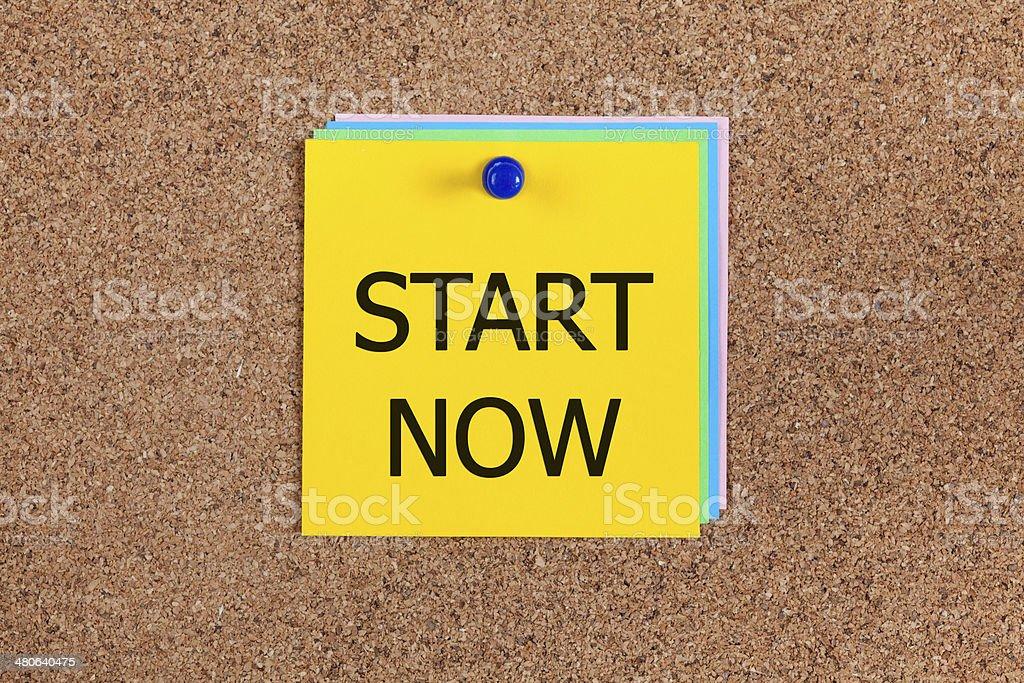 Start now on corkboard stock photo