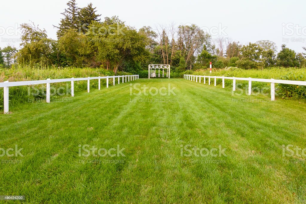 Start of half-mile racetrack for training at public equestion center stock photo