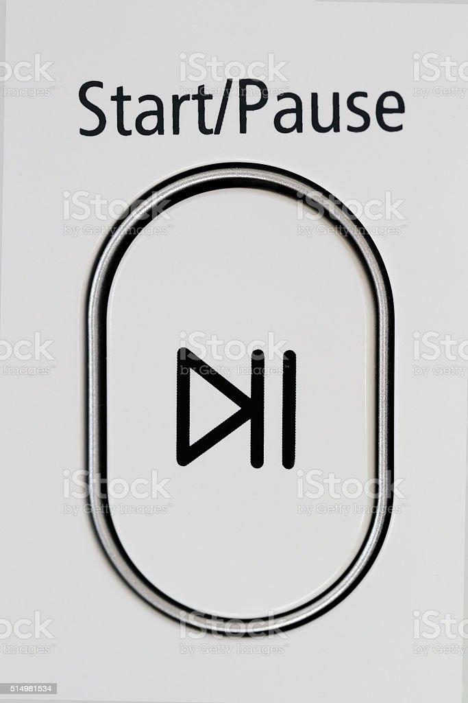 Start Pause button on appliance stock photo