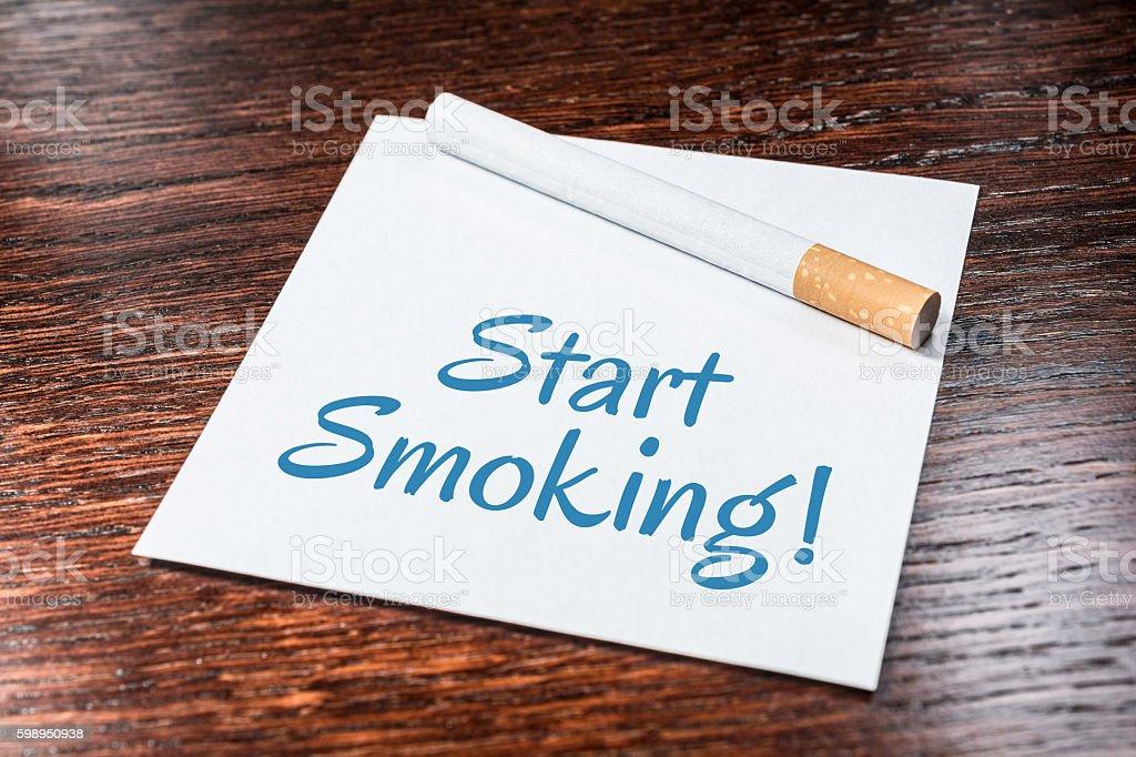 Start Smoking Reminder With Cigarette On Wooden Shelf stock photo