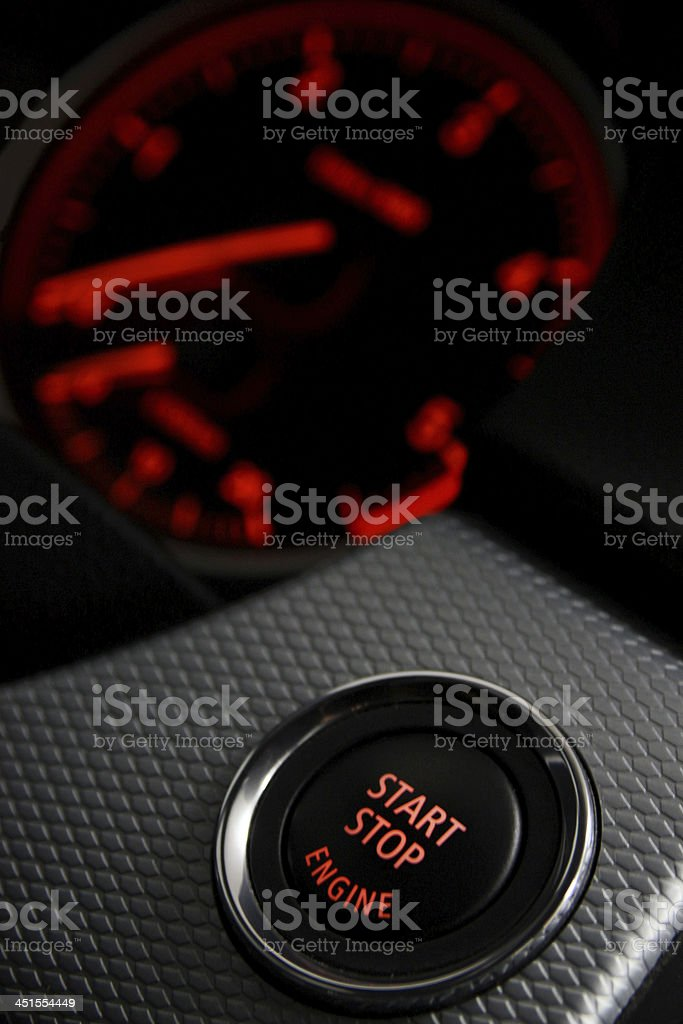 Start Stop engine button in a sport car stock photo