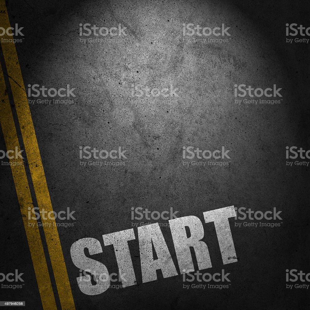 Start text on road stock photo
