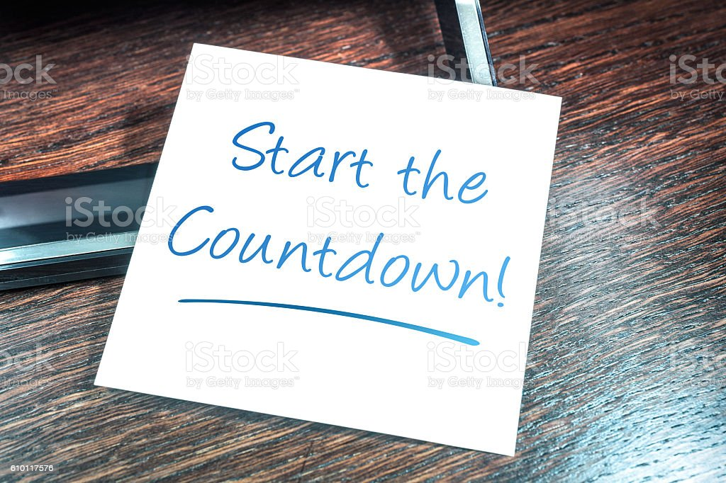 Start The Countdown Reminder On Paper On Wooden Cupboard stock photo