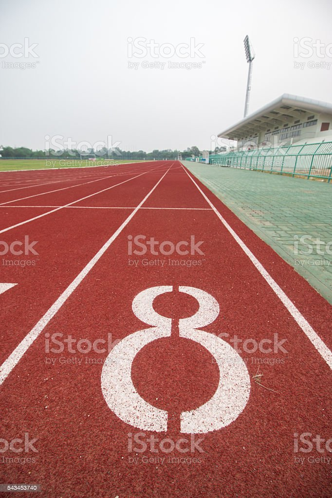 Start track number 8 on red running track. stock photo