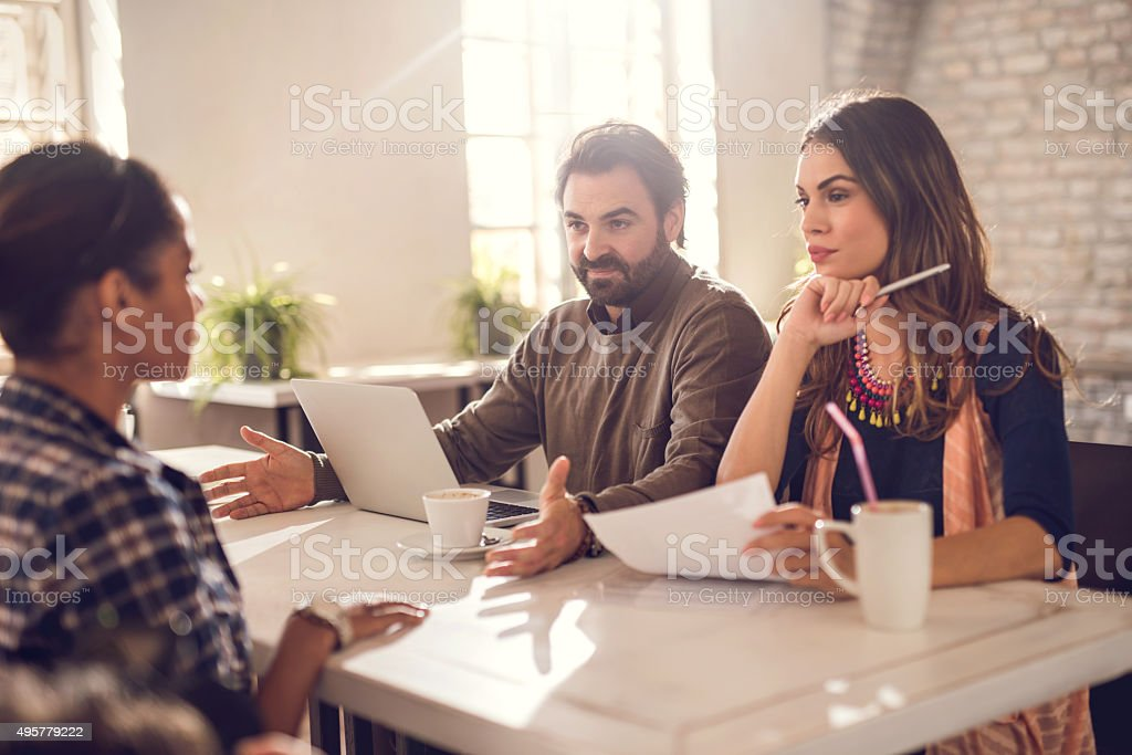 Start up team having a job interview with a candidate. stock photo