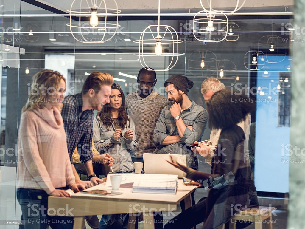 Start up team talking on a meeting in the office. stock photo