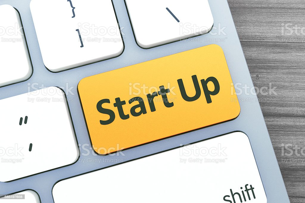 Start Up Text on a Button on Modern Computer Keyboard. stock photo