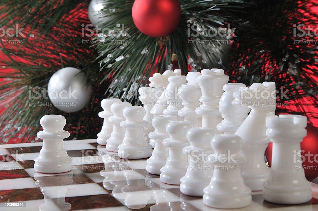 Start. White chess in Christmas decoration stock photo